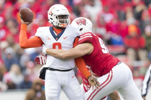 Illinois falls to Wisconsin on the road, 49-20