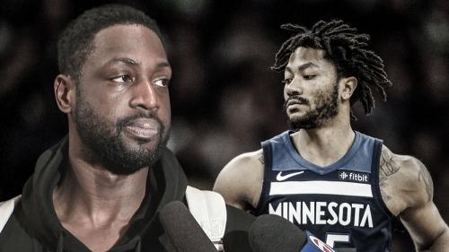 Heat star Dwyane Wade reacts to Timberwolves guard Derrick Rose's career night