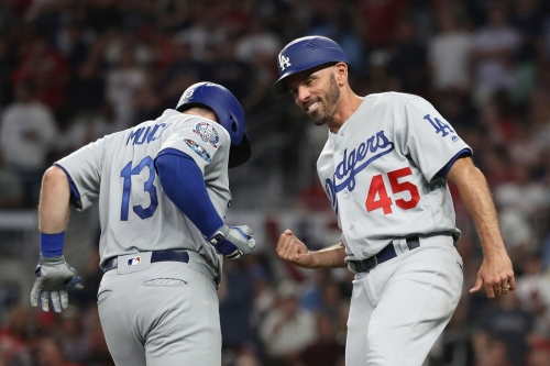 Reports: Los Angeles Dodgers third-base coach Chris Woodward hired as next Rangers manager