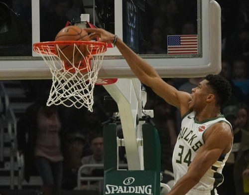 Giannis put his fellow countryman on a poster as part of dunk-friendly showing against Sacramento Kings. See a bunch of them here