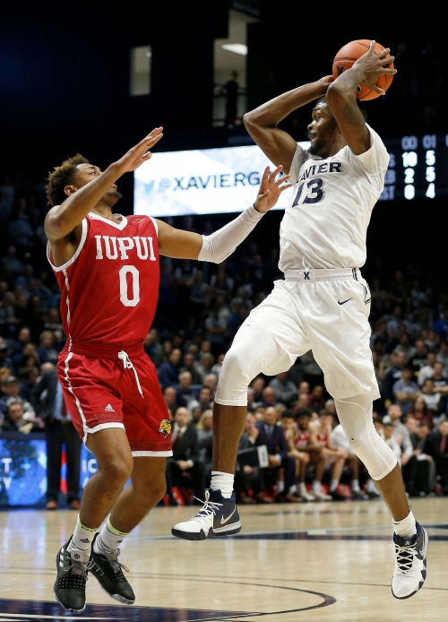 A gutsy performance from Naji Marshall helped Xavier by IUPUI in its opener