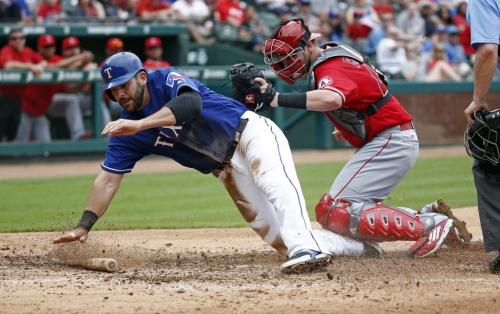 Rangers add major-league experience, organizational depth at catcher