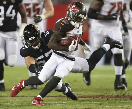 Bucs place Evan Smith and Shaun Wilson on injured reserve, Dare Ogunbowale, Kevin Minter signed