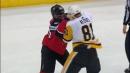 Kessel and Seney drop the gloves during Devils' fast break