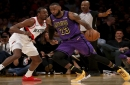 The Los Angeles Lakers' LeBron James (23) drives against the Portland Trailblazers' Al-Farouq Aminu in the third quarter on Wednesday, Nov. 14, 2018, at Staples Center in Los Angeles. The Lakers won, 126-117.
