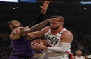 The Los Angeles Lakers' Tyson Chandler, left, gets tangled up with the Portland Trailblazers' Jusuf Nurkic in the secood quarter on Wednesday, Nov. 14, 2018, at Staples Center in Los Angeles. The Lakers won, 126-117.