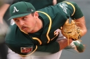 Hearing crying puppies trapped in a storm drain, A's pitcher flies into action