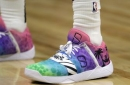 Kick game: Nets' Dinwiddie plays with artwork on his feet