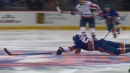 Islanders' Johnny Boychuk dives on ice to prevent a Capitals' breakaway