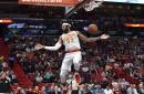 Hawks use late run to douse Heat in Miami