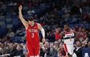 Davis, Holiday lead Pelicans past Wizards 125-104