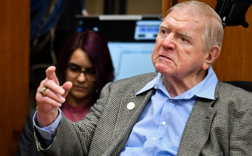 Michigan State University trustee George Perles resigns effective immediately