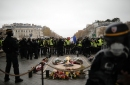 French protesters angry about taxes scuffle with police