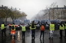 The Latest: 63 arrested in clashes with police in Paris