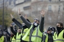 The Latest: 65 injured, 140 arrested in Paris protests