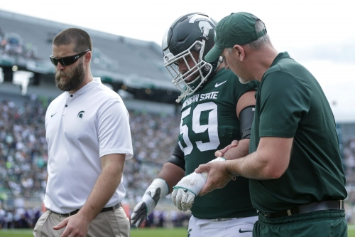 How much did Michigan State's injuries compound offensive problems?
