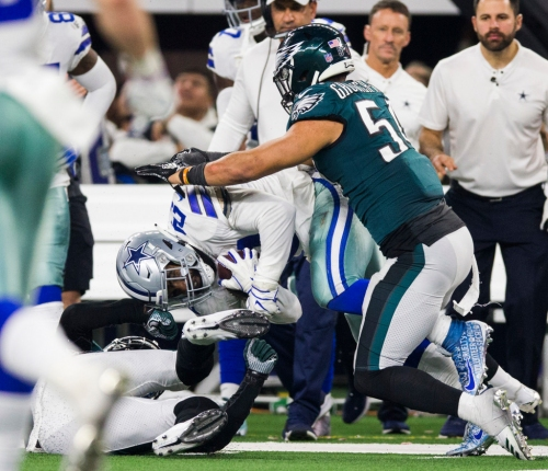 Cowboys RB Ezekiel Elliott reacts to his helmet-lowering penalty, the NFL's first against an offensive player this season