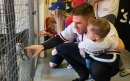 PHOTOS: Braves players Freeman and Culberson visit Cobb pet shelter