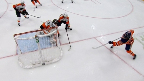Connor McDavid banks puck in off Stolarz from below goal line