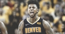 Nick Young reacts to Nuggets fans chanting his name at home debut