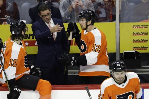 Hart, Gordon win in debuts as Flyers top Red Wings 3-2
