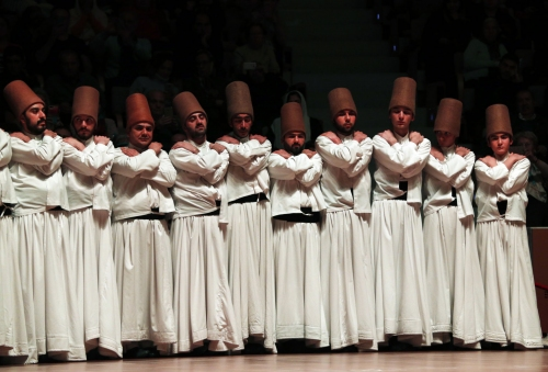 AP PHOTOS: Turkey's whirling dervishes honor Sufi poet