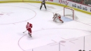Red Wings' Athanasiou beats Flames' Smith on penalty shot