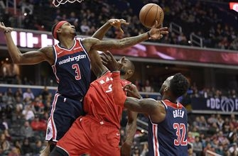 Ibaka's 3-pointer helps Raptors survive Wizards in double OT