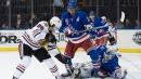 Lundqvist ties Sawchuk on wins list as Rangers beat Blackhawks