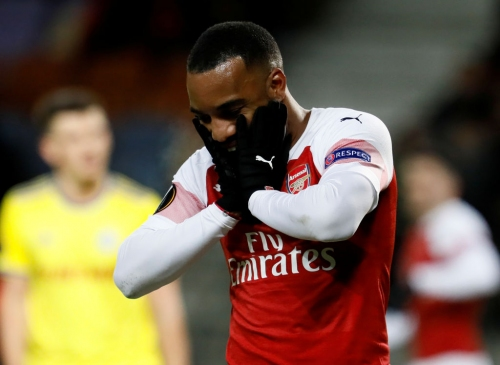 Unai Emery is harming Arsenal's strikers by dropping Mesut Ozil, says Andrew Cole