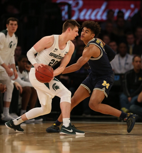 Michigan or Michigan State as No. 1 seed: Bracketologists split for now