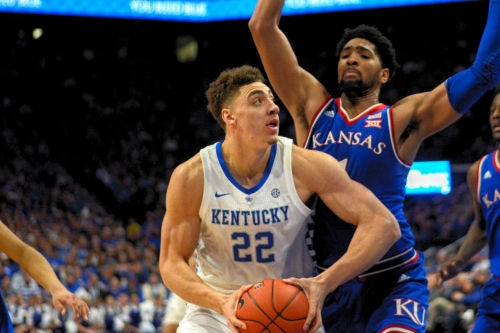 Reid Travis steps up early, propels cold-shooting Cats to victory