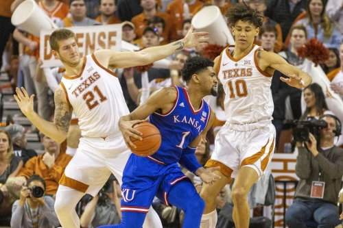 Smothering defense guides Texas to 73-63 upset win over No. 11 Kansas