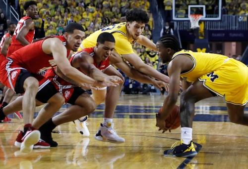 Zavier Simpson's triple-double carries Michigan past Ohio State, 65-49