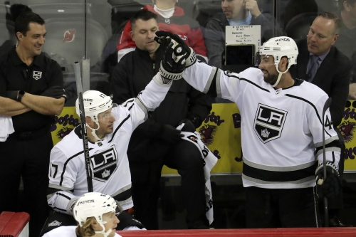 Kings within reach of playoffs after two road wins