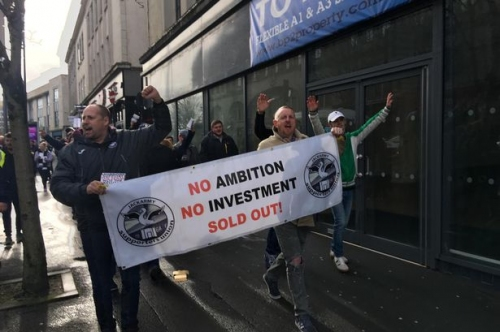 Hundreds of Swansea City fans march through streets to protest against the club's American owners
