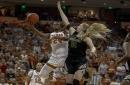Holmes scores 22, leads No. 14 Texas women's basketball over Kansas