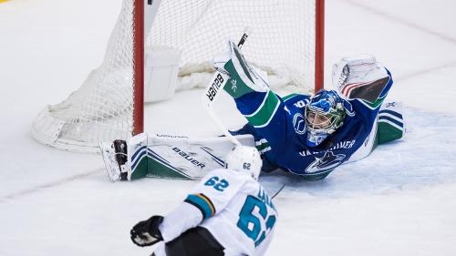 Sharks crush Canucks in Michael DiPietro's NHL debut