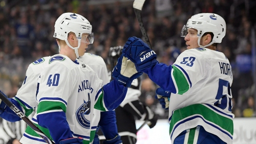 Canucks rally to beat Kings in shootout, end road losing streak at 4