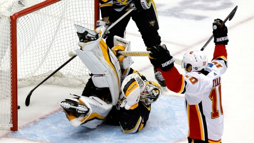 Flames beat Penguins to snap four-game losing streak