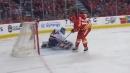 Frolik's slick pass, Backlund's quick deke get Flames on the board