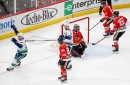 Kane reaches 100 points, Blackhawks lose 3-2 in OT to Canucks