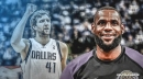 Lakers' LeBron James reacts to Mavs' Dirk Nowitzki passing Wilt Chamberlain on all-time scoring list