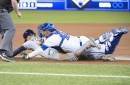 Buchholz shines in debut, Jays rally late to stifle Rays