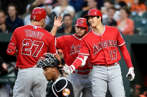 Mike Trout drives in 3 runs in Angels' victory on rainy night