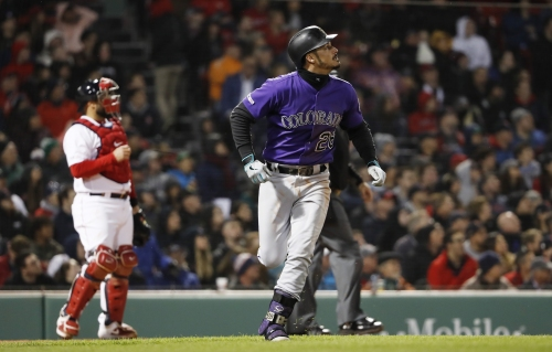 Rockies beat Red Sox in 11 innings despite striking out 24 times