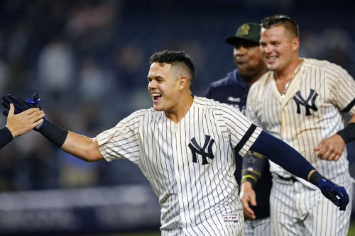 Yankees take AL East lead in 4-3 win over the Rays