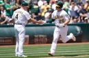 Laureano, Chapman start to get hot as A's win eighth straight