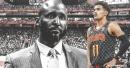 Hawks' Trae Young and head coach Lloyd Pierce attend Atlanta Dream game