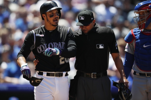 Nolan Arenado pulled from series finale vs Cubs after being drilled on forearm by Cole Hamels